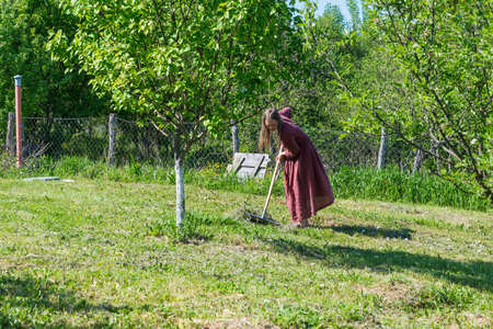 Girl work on the plot of land