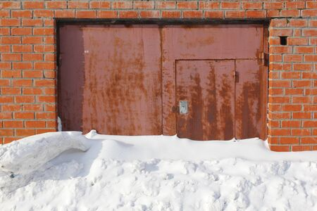 closed garage doors, covered with snow