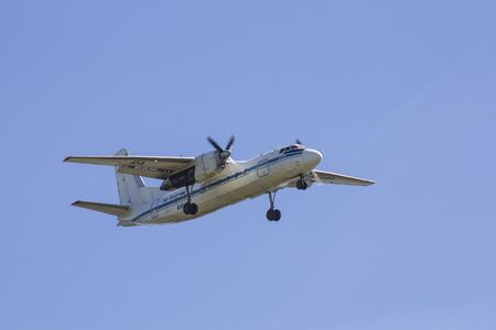 A small twin-engine passenger plane lands at the airport. The end of the flight. Aircraft landing and take-off