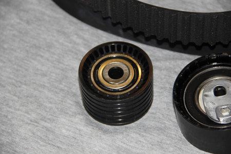 Automotive Parts - New Engine Attachment Belt Rollers. New drive belt rollers for car engine accessories.
