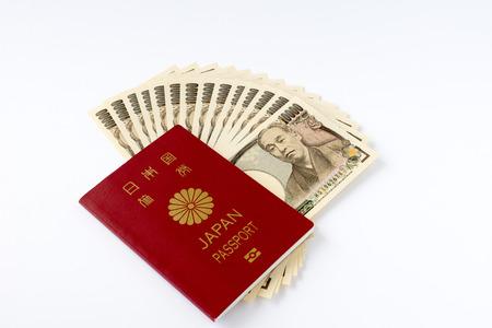 日本のパスポートと 10000 円札 写真素材