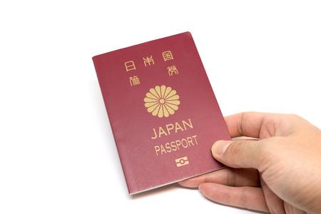 パスポートを手に日本します。 写真素材