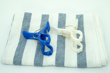 clothespins: Stripe fabric with clothespins Stock Photo