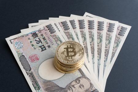 Bitcoin and Japanese Yen Stock Photo