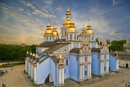 Saint Michael Gilded Russian Orthodox cathedral and a church with wooden dome, Kiev, Ukraine photo