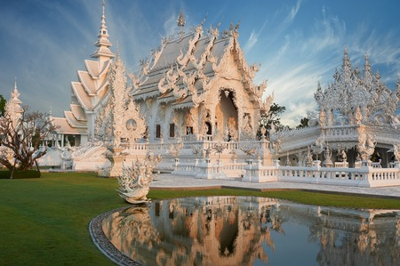 thailand temple: Beautiful ornate white temple located in Chiang Rai northern Thailand. Wat Rong Khun (White Temple), is a contemporary unconventional Buddhist temple.Buddhist and Hindu motifs.