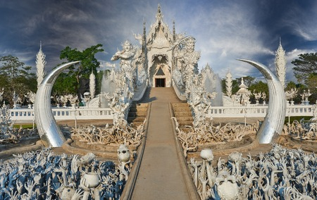 Beautiful ornate white temple located in Chiang Rai northern Thailand.  photo