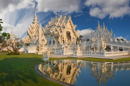 veneration: Beautiful ornate white temple located in Chiang Rai northern Thailand. Stock Photo