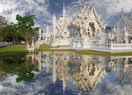 Beautiful ornate white temple located in Chiang Rai northern Thailand. Wat Rong Khun (White Temple), is a contemporary unconventional Buddhist temple.Buddhist and Hindu motifs. photo