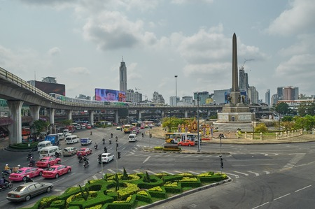 Bangkok, Thailand - February 26, 2014: View on the Victory Monument the big military monument in Bangkok on 14 October 2006. The monument has been established in June 1941 to mark a victory in war with Frenchmen. Bangkok, Thailand - February 26, 2014