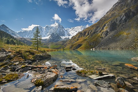 snow capped mountains: Mountain lake, Russia, Siberia, Altai mountains, Chuya ridge. Stock Photo