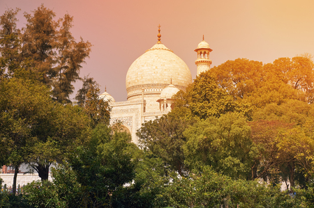 The Taj Mahal is an ivory-white marble mausoleum on the south bank of the Yamuna river in the Indian city of Stock Photo