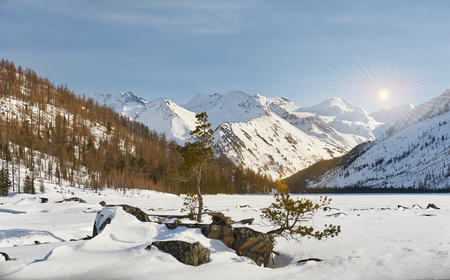 Beautiful winter landscape,the harsh, cold winter Altai, Severe mountains peaks covered by snow, Beautiful fresh snow. Russia, Siberia, Altai mountains.