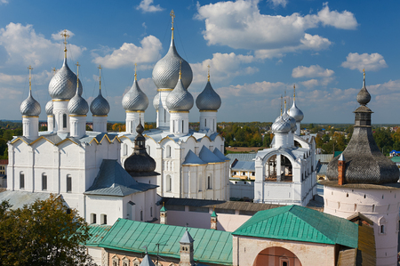 old brick wall: Assumption Cathedral and church of the Resurrection in Rostov Kremlin. The ancient town of Rostov The Great is a tourist center of the Golden Ring of Russia. Stock Photo