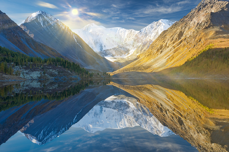 river: Landscape of Roerich. Akkem Valley. In the background is Belukha Mountain. A beautiful autumn landscape, a view of the mountain lake, Russia, Siberia, Altai, Katunsky ridge.