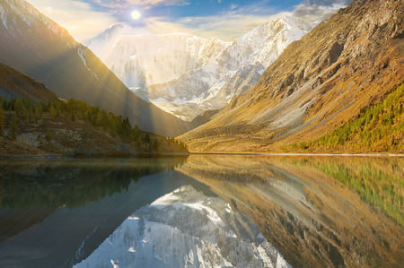 Landscape of Roerich. Sunny day Akkem Valley. In the background is Belukha Mountain. A beautiful autumn landscape, a view of the mountain lake, Russia, Siberia, Altai, Katunsky ridge. Stock Photo