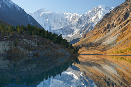 Landscape of Roerich. Akkem Valley. In the background is Belukha Mountain. A beautiful autumn landscape, a view of the mountain lake, Russia, Siberia, Altai, Katunsky ridge.