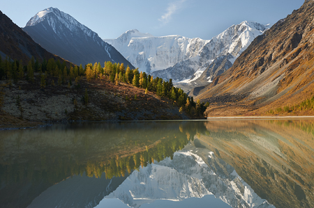 gold capped: Landscape of Roerich. Akkem Valley. In the background is Belukha Mountain. A beautiful autumn landscape, a view of the mountain lake, Russia, Siberia, Altai, Katunsky ridge.