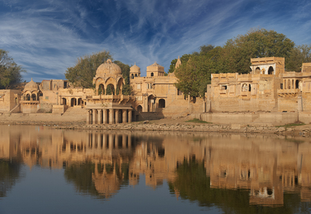 Indian landmarks Gadi Sagar temple on Gadisar lake Jaisalmer, Rajasthan, north India.