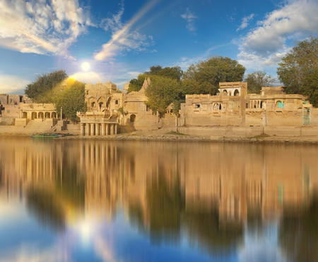 Sunny afternoon indian landmarks Gadi Sagar temple on Gadisar lake Jaisalmer, Rajasthan, north India.