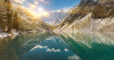 Snow winter mountain lake bright and early, Russia, Siberia, Altai mountains, Chuya ridge.