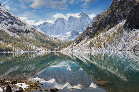 Snow covered winter mountain lake, Russia, Siberia, Altai mountains, Chuya ridge. Stock Photo