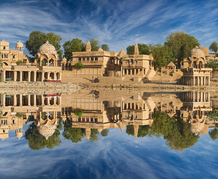 Indian landmarks Gadi Sagar temple on Gadisar lake Jaisalmer, Rajasthan, north India.