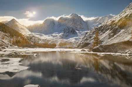 Snow-covered winter mountain lake, Russia, Siberia, Altai mountains, Chuya ridge.