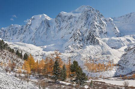 Snow-covered winter mountain lake, Russia, Siberia, Altai mountains, Chuya ridge.