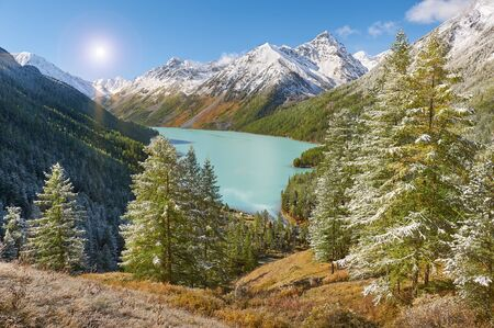 Bright sunny day. Mountain lake Russia West Siberia Mountain landscape with a lake and forest in the foreground.