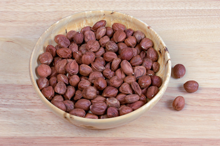 nutty: hazelnut  food nut wood bowl, photography,brown, organic  peeled  shot, nutty  full Stock Photo