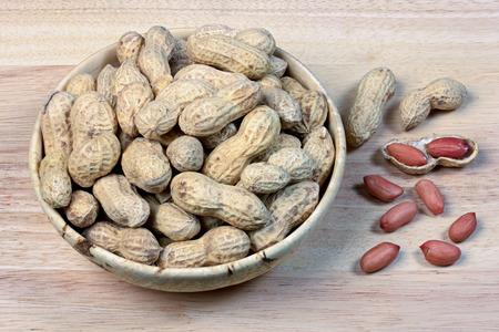 nutshell: peanut  food  close-up  nut  pod  nutshell  seed  nutty  full  wood  dried bowl
