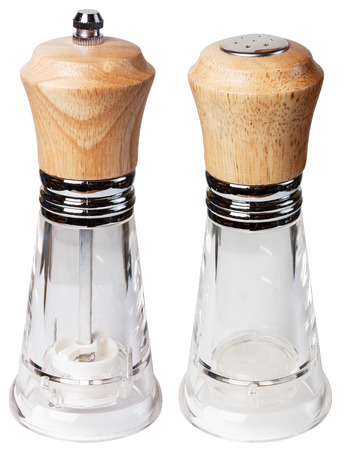 pepperbox: Pepper glass with wooden lid, salt shaker glass, isolate on a white background close-up. Stock Photo