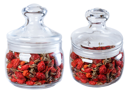 wild rose: Dried wild rose in a glass jar, isolate on a white background in two ways.