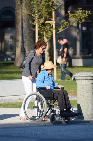 wheelchair users: a disabled senior citizen on a wheelchair Editorial