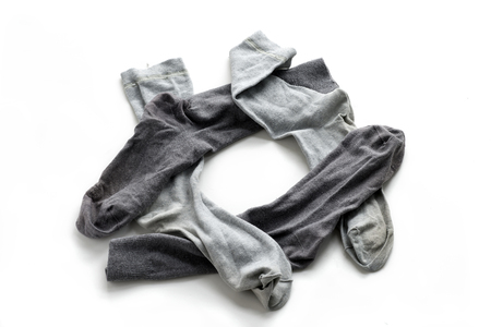 laundered: Clean laundered mens socks on a white background