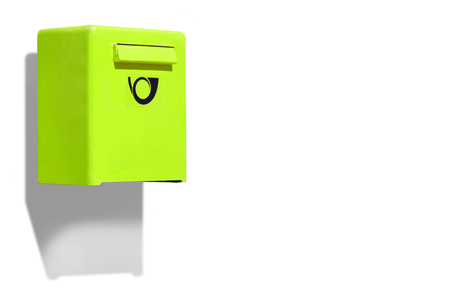 metal mailbox: Green letterbox on white wall Stock Photo