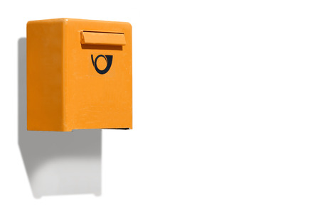 letterbox: Orange letterbox on white wall