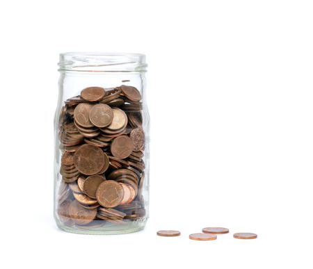 pile of coins: Coins in a glass jar. Saving money for you