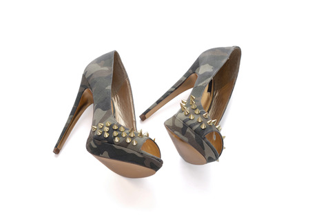 spiked: Camouflage high-heeled shoes with spikes.