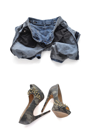 turned out: Erasing blue jeans for women. Turned inside out and camouflage high-heeled shoes with spikes.