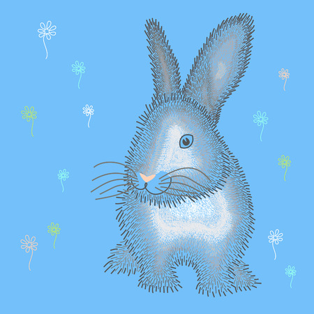 extreme close up: Fluffy blue Easter bunny on glade.