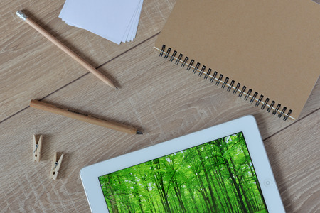 commercial tree care: Natural stationery in the world today. Natural and ecological life. Green forest in your tablet.