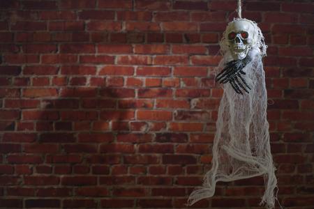 Terrible skeleton on the gallows. Halloween Spirit.