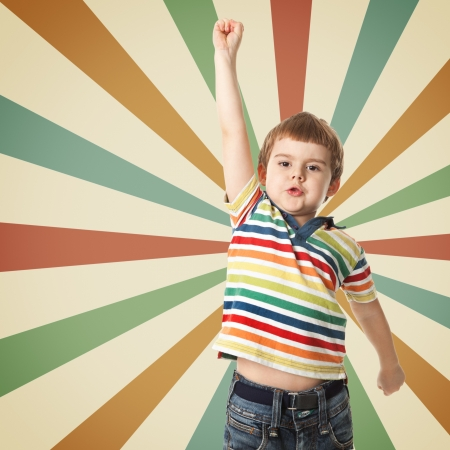 Cheerful little boy raised his hand up  Shooting in the studio