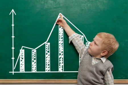 Cheerful smiling  child at the blackboard  School concept   Stock Photo