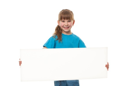 Portrait of a  smiling girl holding blank sheet against white background  Advertising concept  Isolated on white photo