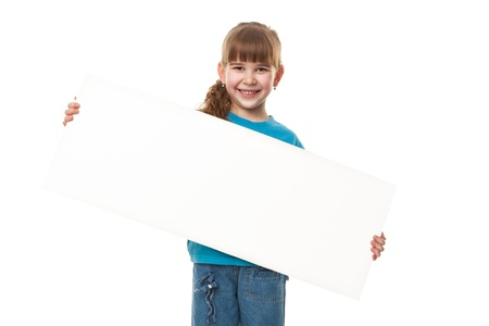 Portrait of a  smiling girl holding blank sheet against white background  Advertising concept  Isolated on white Stock Photo