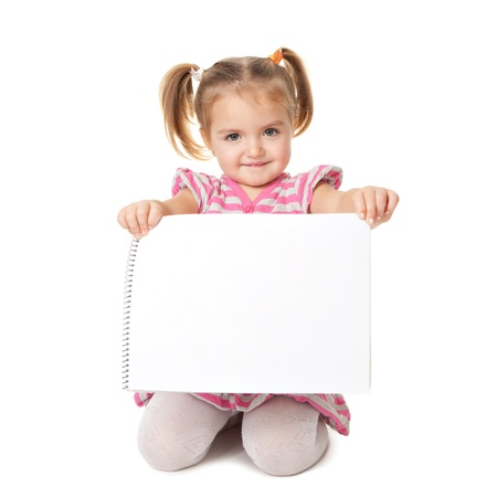 holding blank sign: child with white sheet on a white background. Advertisement concept