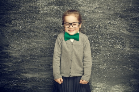 Beautiful smiling girl on a black background  School concept Stock Photo - 19164939